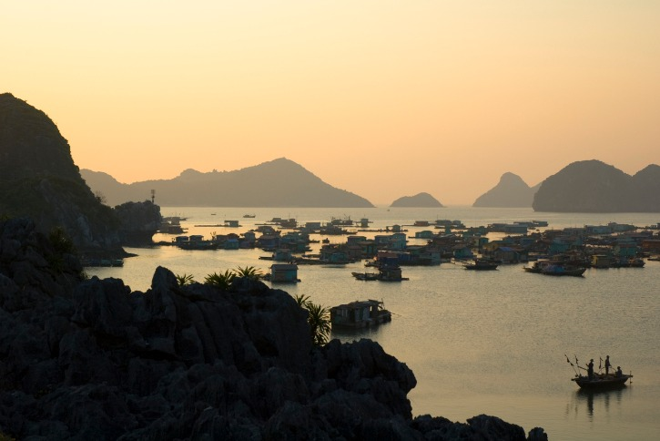 Sunset over the floating village in Halong Bay